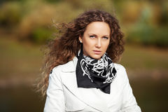 Happy beautiful fashion woman in white coat Royalty Free Stock Image