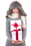 Happy beautiful woman in winter clothes with christmas presents Stock Photos