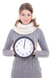 Happy beautiful woman in winter clothes with clock isolated on w stock image