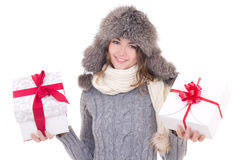 Happy beautiful woman in winter clothes with gift boxes isolated Royalty Free Stock Photography
