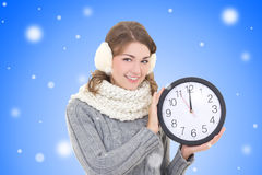 Happy beautiful woman in winter clothes holding office clock ove Royalty Free Stock Photo