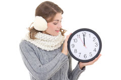 Happy beautiful woman in winter clothes with office clock isolat Stock Photo