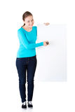 Happy beautiful woman writing with a pen on blank board. Stock Photography