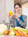 Happy beautiful woman with yellow pepper Royalty Free Stock Photo