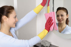 Happy beautiful women after cleaning the house stock image