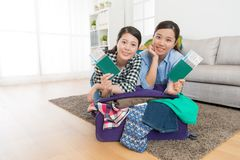 Happy beautiful women leaning on luggage suitcase Stock Photo