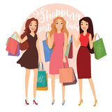 Happy beautiful women with shopping. Three ladys with shopping bags walking on street. Big Sale. Group of young pretty woman with shopping bag enjoy shopping Royalty Free Stock Image