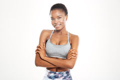 Happy beautiful young african american sportswoman standing with arms crossed Royalty Free Stock Photo