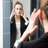 Happy beautiful young business woman checking her makeup on morning Royalty Free Stock Images