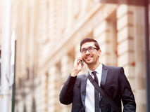 Happy beautiful young businesswoman using smart phone smiling Royalty Free Stock Photography