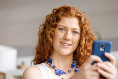 Happy beautiful young businesswoman using smart phone smiling Stock Images