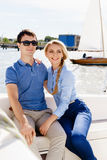 Happy and beautiful young couple having a rest on a yacht. Trave Royalty Free Stock Image
