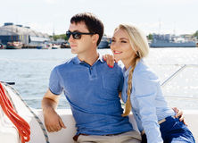 Happy and beautiful young couple having a rest on a yacht. Trave Royalty Free Stock Photo