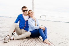 Happy and beautiful young couple having a rest on a yacht. Trave Stock Image