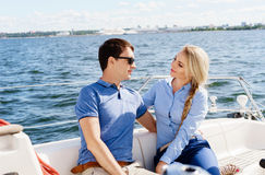 Happy and beautiful young couple having a rest on a yacht. Traveling, tourism, journey, concept. stock photo