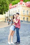 Happy beautiful young couple in love huging and have a fun together in the city. On summer day stock image