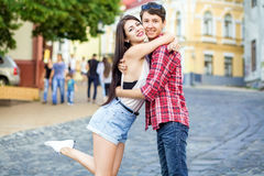 Happy beautiful young couple in love huging and have a fun together in the city. On summer day stock photo