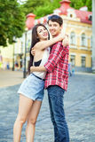 Happy beautiful young couple in love huging and have a fun together in the city. On summer day stock photography