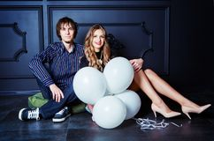 Happy beautiful young couple with white balloons Royalty Free Stock Image