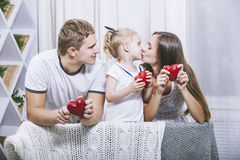 Happy beautiful young family father, mother and daughter with he Royalty Free Stock Photos