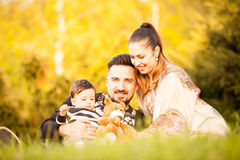 Happy beautiful young family with her son in a walk in the park Stock Photography