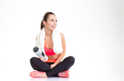 Happy beautiful young sportswoman with towel on her neck Royalty Free Stock Photo
