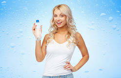 Happy beautiful young woman with bottle of water Stock Photo