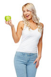 Happy beautiful young woman with green apple Stock Photography