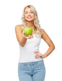 Happy beautiful young woman with green apple Royalty Free Stock Photos