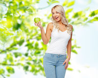 Happy beautiful young woman with green apple Stock Photos