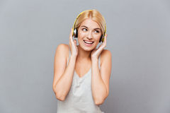 Happy beautiful young woman in headphones listening to music Stock Image