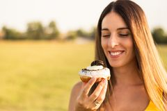 Happy woman holding donuts royalty free stock photos