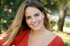 Happy beautiful young woman laughing and smiling on nature Royalty Free Stock Image