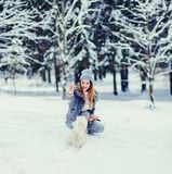 Beautiful young woman playing in a winter day stock image