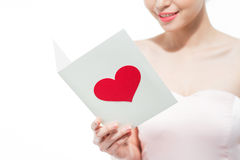 Happy beautiful young woman reading love greeting card. Stock Photos