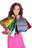 Happy beautiful young woman with shopping bags Stock Photos