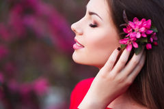 Happy beautiful young woman in spring blossom park. Stock Photography