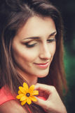 Happy beautiful young woman in spring blossom park. Royalty Free Stock Images