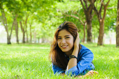 Happy. Beautiful young woman in a spring park Royalty Free Stock Photos