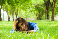 Happy. Beautiful young woman in a spring park Royalty Free Stock Images