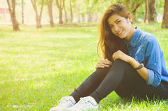 Happy. Beautiful young woman in a spring park Stock Images