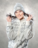 Happy beautiful young woman in stylish woollen knitted clothes Royalty Free Stock Photography
