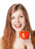 Happy beautiful young woman with tomato Stock Photos