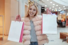 Beautiful young woman shopping at the local mall stock photography