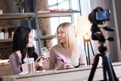 Happy beauty bloggers looking at each other Royalty Free Stock Image