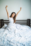 Happy beauty morning of beauty girl streching in bed. Happy morning of beauty girl streching in bed Royalty Free Stock Images