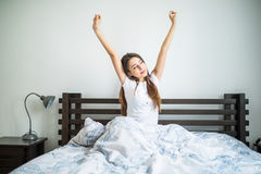 Happy beauty morning of beauty girl streching in bed. Happy morning of beauty girl streching in bed Stock Images