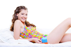 Happy beauty woman in the bed. Young happy beauty woman in the bed on white background Stock Photo