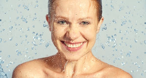 Happy beauty woman skin care, washing with splashes of water Royalty Free Stock Photography
