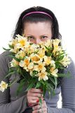 Happy beauty woman with yellow flowers Stock Image